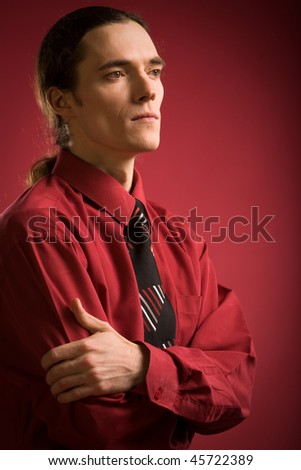 Sad man in red shirt on red background - stock photo