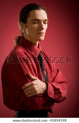 Sad man in red shirt on red background