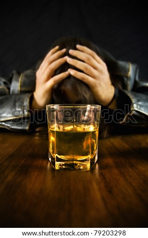 Sad man on the bar after a night of drinking. - stock photo