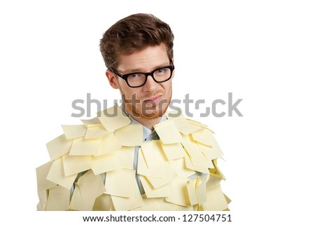 Sad  man with a glasses covered with yellow stickers, isolated on white background