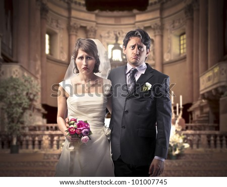 Sad marrying couple in a church