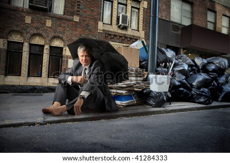 sad mature businessman seated near to garbage