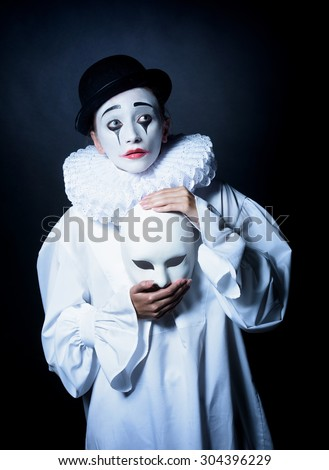 Sad mime Pierrot with a mask
