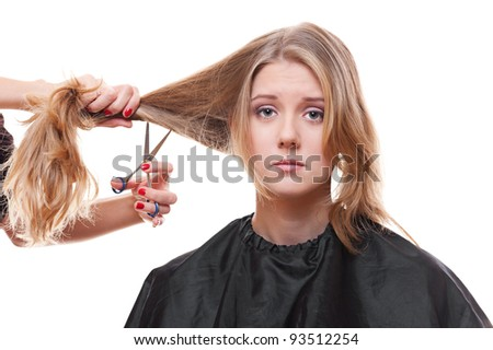 sad model in hairdressing salon. isolated on white background - stock photo