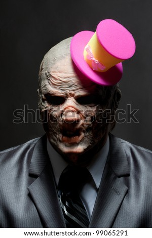 Sad monster in business suit with funny pink hat - stock photo