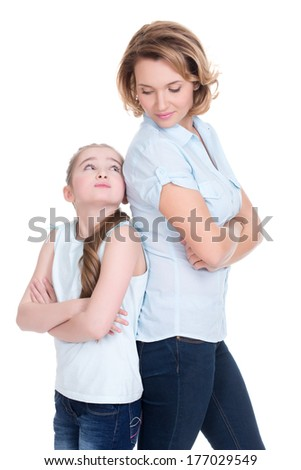 Sad mother and daughter having problem or quarrel standing back to back studio isolated on white - stock photo