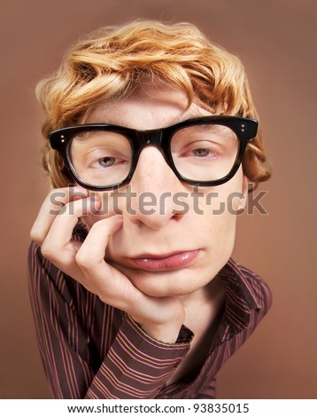 Sad nerdy guy - stock photo