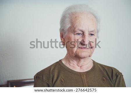 Sad older woman - stock photo