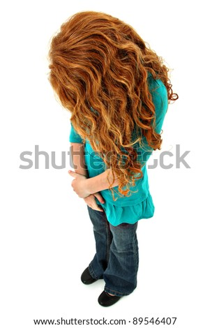Sad or lonely young girl child standing over white looking down, face hidden.