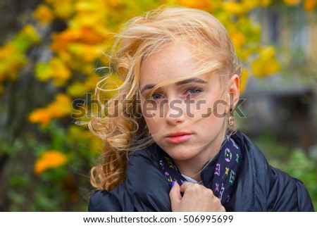 sad pensive woman with long curly hair portrait