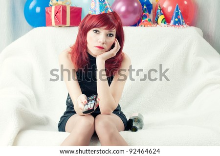 Sad Red Haired Party Woman Sitting At Home And Watching TV