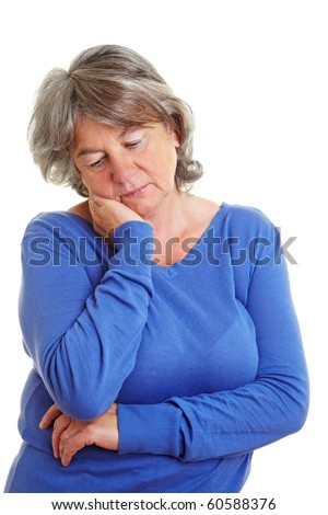 Sad retired woman with gray hair looking down - stock photo
