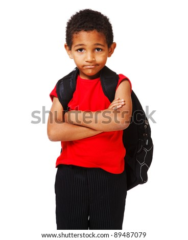 Sad schoolboy with his arms crossed - stock photo