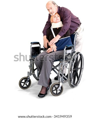Sad Senior Male & Female Couple with injured woman in wheelchair in casual outfit - Isolated