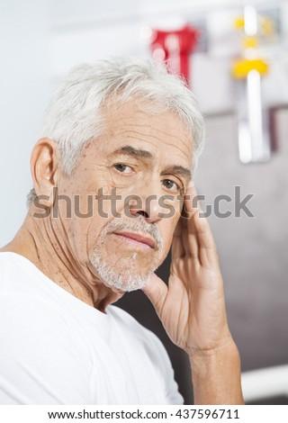 Sad Senior Man At Rehab Center - stock photo