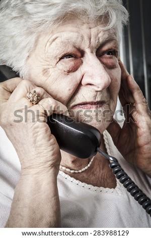 Sad senior phone - stock photo