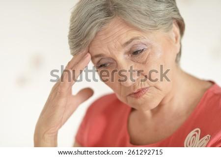 Sad senior woman - stock photo