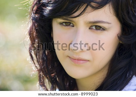 Sad teen portrait with scene reflected in her eyes. - stock photo
