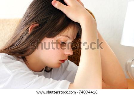 sad teenage girl indoor interior - stock photo