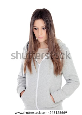 Sad teenager girl with gray sweatshirt isolated on white background - stock photo