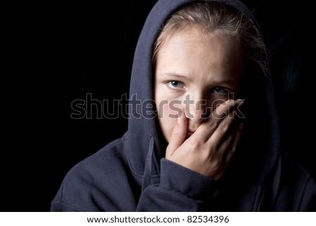 Sad teenager is in depression - stock photo