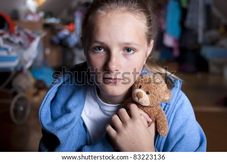 Sad teenager is scared and abused. - stock photo