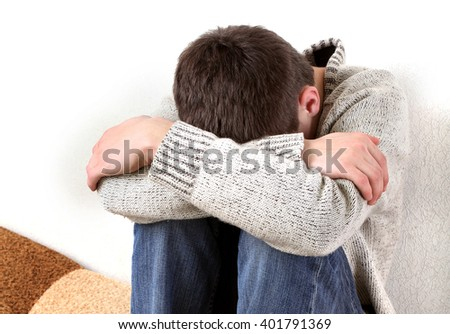 Sad Teenager on the Sofa hide the Face and Crying - stock photo