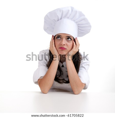 sad, thoughtful female cook in white uniform and hat