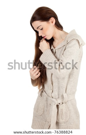 sad, thoughtful young long hair woman in bright sweater