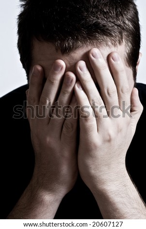Sad Unhappy Ashamed Man Covering his Face - stock photo