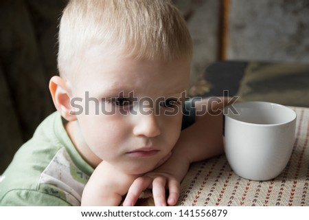 Sad upset tired worried little child (boy) close up portrait - stock photo
