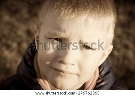 Sad upset tired worried unhappy little child (boy) close up horizontal, expressive eyes  - stock photo