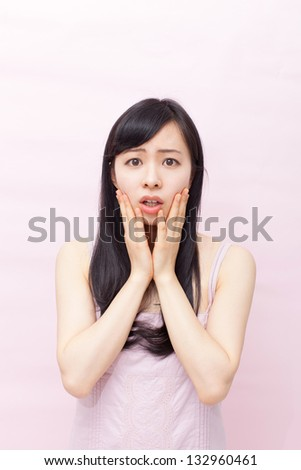 Sad woman against pink background - stock photo