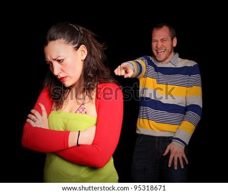sad woman being laughed about because her mean friend is mobbing her - stock photo