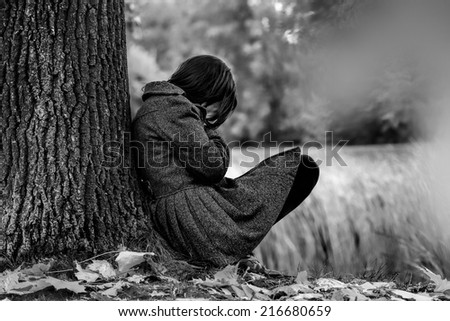 Sad woman crying after break up in the park - stock photo