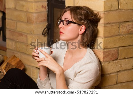 sad woman drinking coffee or tea