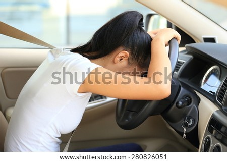 sad woman driver in car  - stock photo