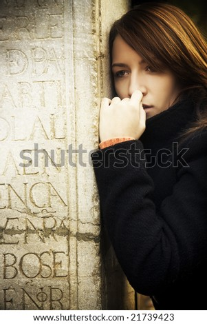 Sad woman embracing a grave. - stock photo