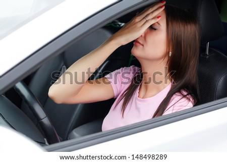 Sad woman in a car
