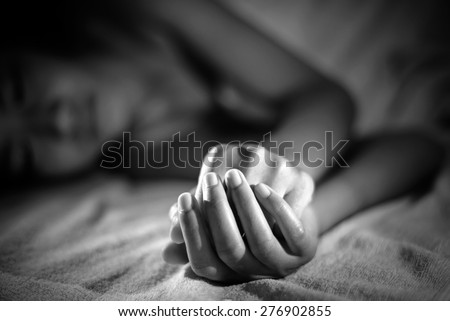 sad woman is lying in bed at night , dark feeling - stock photo