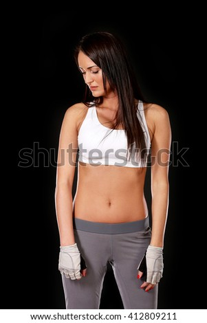 Sad woman looking down, fight in boxing, isolated on black background - stock photo
