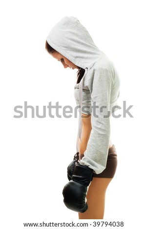 Sad woman loss the fight in boxing, stand and hang her head, isolated on white