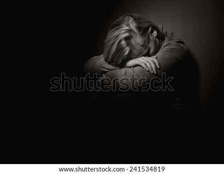 Sad woman. MANY OTHER PHOTOS FROM THIS SERIES IN MY PORTFOLIO. - stock photo
