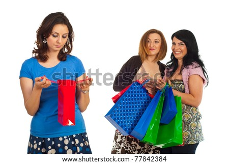 Sad woman of small shopping bag and two selfish women with many bags laughing and joking about their friend isolated on white background - stock photo