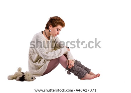 Sad woman on the white floor - stock photo