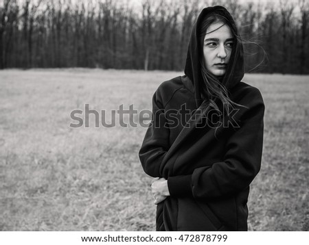Sad woman outdoors. Black and white