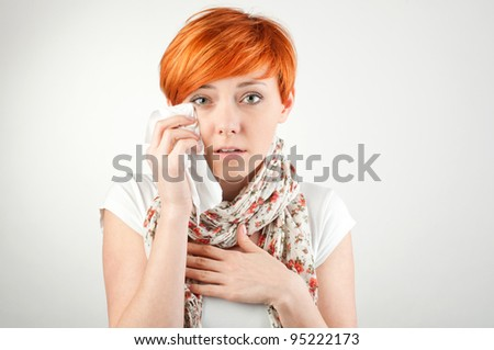 sad woman with a handkerchief