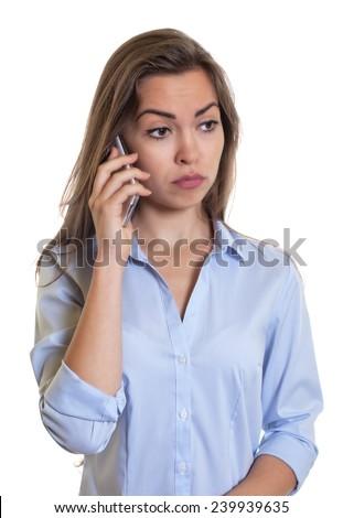 Sad woman with long dark hair at phone - stock photo