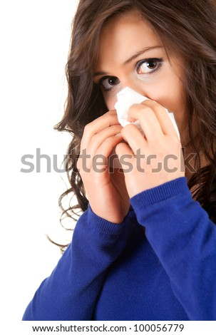 sad woman with snotty, runny nose and handkerchief, white background