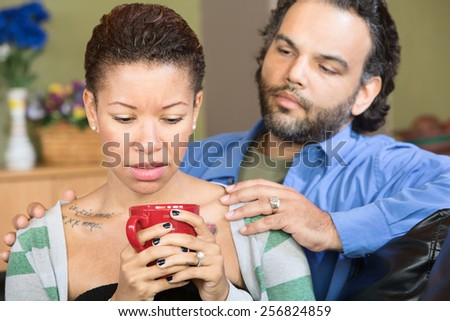Sad woman with tattoo and concerned man with beard - stock photo